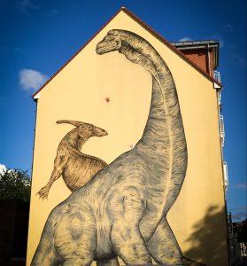 Dinowandbild von Kay Elzner in der Olvenstedter Straße